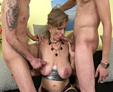 Horny mature slut with big tits sucking and fucking two younger guys
