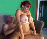 Redhead Milf with huge tits fucks on couch